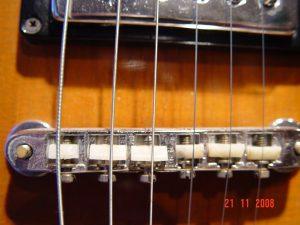Gibson SG Deluxe Tuneomatic Bridge Plastic Saddles Guitarwacky.com