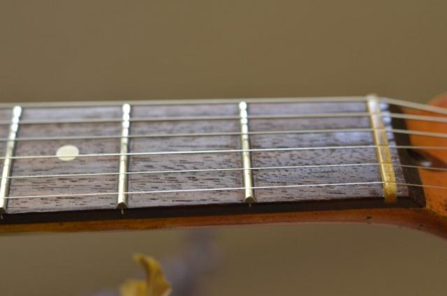 Aged rosewood fretboard